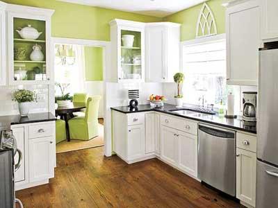 Cocina grande pintada de color verde.